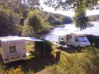 Camper van park area in aubrac by a lake in aveyron